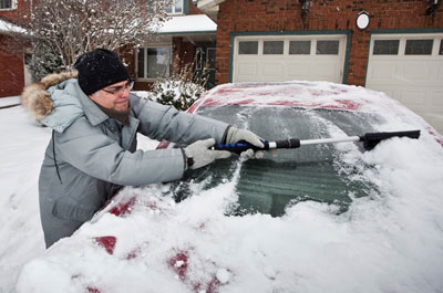 scraping ice and snow off widshield
